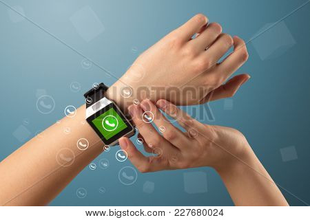 Female handwearing a ringing smartwatch with call icons around