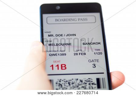 Man Hand Holding Mobile Phone With Mobile Boarding Pass. Boarding Pass Is Fake. Isolated Over White