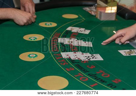 Rimini, Italy - May 2016: Inside Casino: Behind Black Jack Gambling Table, Chips And Cards