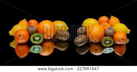 Fresh Fruits On A Black Background With Reflection. Horizontal Photo.