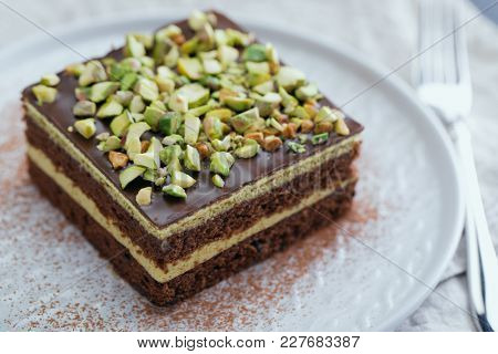 Mozart cake with Chocolate and Pistachio nuts closeup