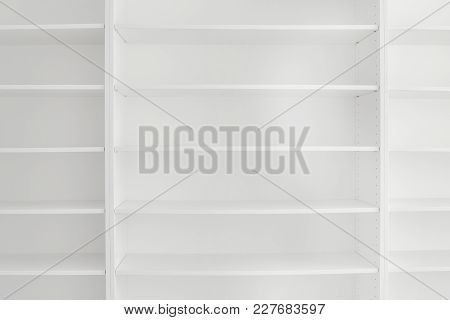 Several Clean And Empty Shelves In A White Bookcase