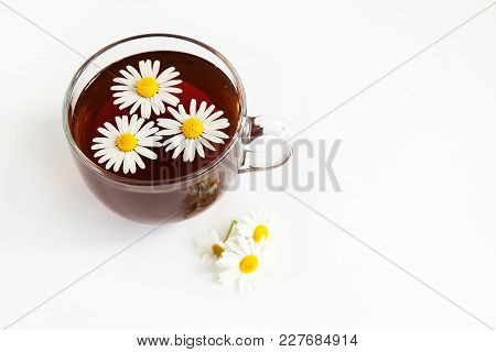 Cup Of Tea With Chamomile Flowewrs On The White Background