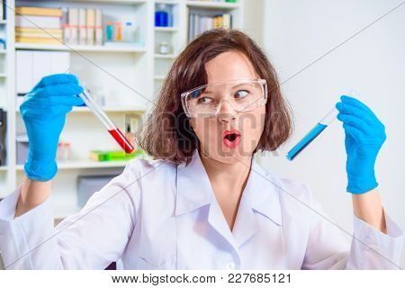 Crazy Girl Scientist Or Researcher Researching In The Laboratory. Different Reagent Flasks And Test