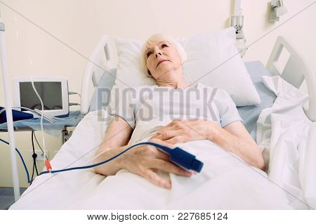 Getting Better Every Day. Poor Senior Woman Thinking About Something Pleasant While Lying In A Hospi