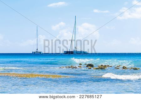 Sailing Catamarans And Waves In The Caribbean Sea. The Island Of Saona Dominican Republic.
