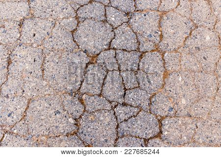 Cracks In The Old Pavement As A Background .