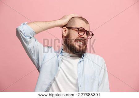 Man Having Headache. Isolated On Pink Background. Business Man Standing With Pain Isolated On Trendy