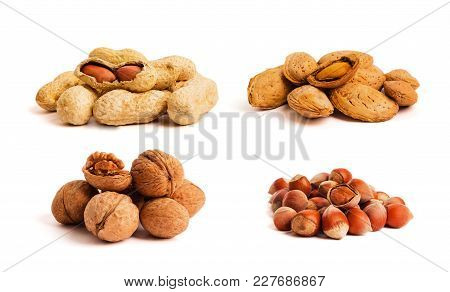 Group Of Walnuts And Splintered Walnut With Heart-shaped Core On Green Background. Walnuts Close Up.