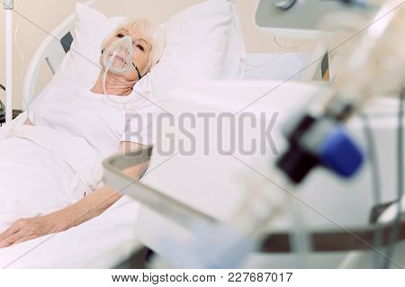 Everything Will Be Ok. Selective Focus On A Senior Lady Thinking About Something While Lying In A Ho