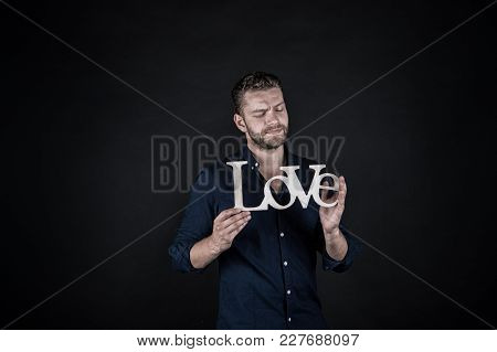 Groom With Serious Face Hold Wooden Love Word On Dark Background. Valentines Day Concept. Love, Roma