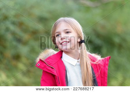 Fashion, Style, Lifestyle. Small Kid In Red Coat Smile On Natural Background, Childhood. Happy Child