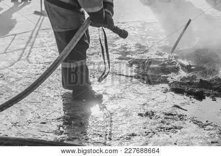 Portrait Of A Firefighter To Extinguish With Water