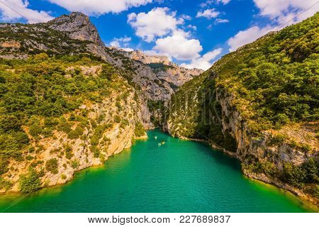 Fascinating journey along the mountain river on catamarans. The Provence Alps. The Verdon River flow between the sheer cliffs of Verdon Canyon, France. Concept of ecological and active tourism