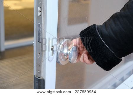 The Hand Opens The Door By The Handle In Winter Time