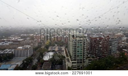 Aerial Elevated View Up Above Evanston, Il On A Rain Cloudy Day With Raindrops On Window