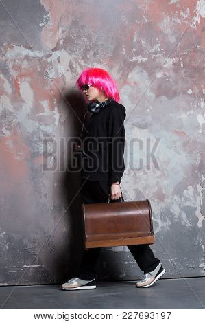Girl In Sunglasses, Sport Suit, Shoes On Abstract Wall. Woman In Pink Hair Wig, Headphones Carry Ret