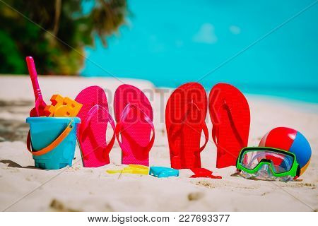 Colored Flip-flops, Toys And Diving Mask At Tropical Beach