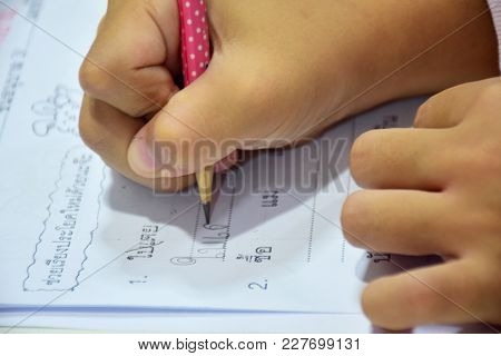 Writing Exercises With Pencil, Doing Exercises, Doing Homework, Using Handwriting Thai Letters.