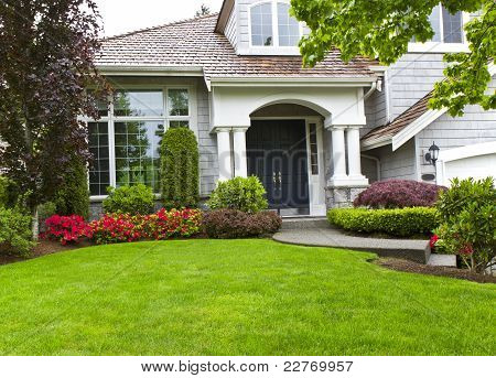 Front yard of modern home during late spring poster
