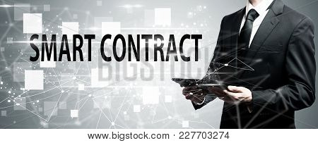 Smart Contract With Man Holding A Tablet Computer