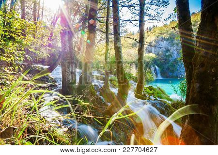 Waterfall With Sunlight Rays In Plitvice Lakes National Park, Croatia