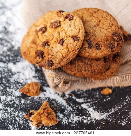 Chocolate Chip Cookies On Dark Background  With Place For Text. Choco Cookie On  Linen Napkin On Bla