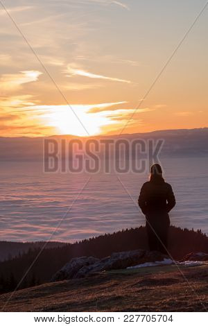 Woman Standing On Summit Of Mountain Schoeckl In Austria And Looking Over Low Stratus In City Graz T