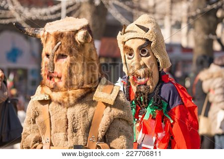 Pernik, Bulgaria - January 26, 2018: Two Dancers Called Kukers March And One Of Them Looks In Camera