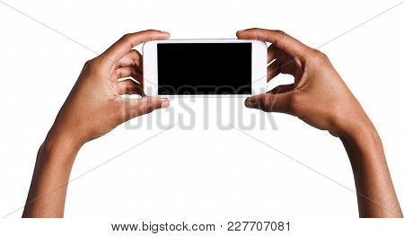 Black Hands Holding Mobile Smartphone With Blank Screen, Isolated On White Background. Copy Space Fo
