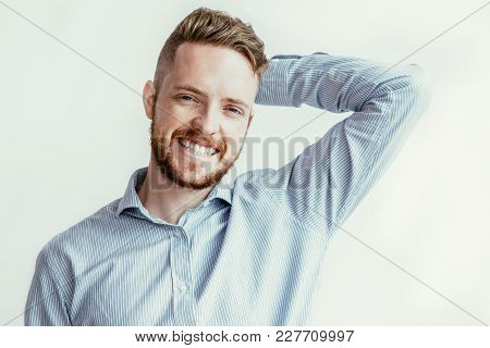 Closeup Portrait Of Smiling Confused Young Man Looking At Camera And Scratching Back Of Head. Isolat