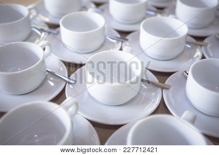 A Group Set Of White Ceramic Coffee Cups To Prepare For A Coffee Time In The Afternoon.