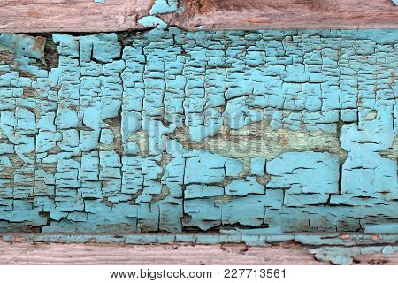 Vintage Wooden Planks With The Remains Of The Blue Paint As Background