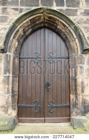 A Strong Wooden Doorway To An Old Church.