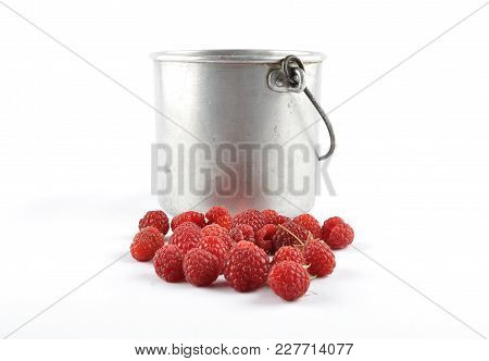 Colorful And Crisp Image Of Red Raspberries With Tin Bucket On White