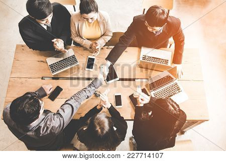 Business Handshake At Meeting Or Negotiation In The Office. Partners Are Satisfied Because Meeting T