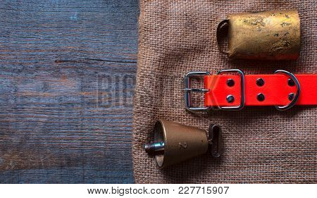 High Quality Bronze Bell And Swiss Bell For Bird Dog Lies On An Old Cloth On A Wodden Background Wit