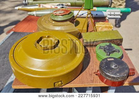 Anti-tank And Anti-personnel Mines On The Stand. Weapons Of War In Ukraine