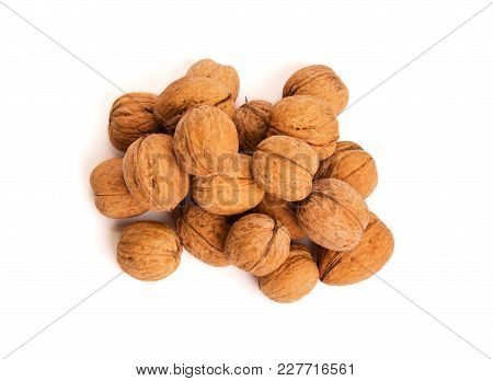 Group Of Walnuts On White. Healthy Food Concept.view Above.
