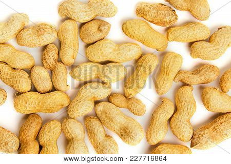 Heap Of Peanuts As Background. Macro View Of Shelled Peanuts.