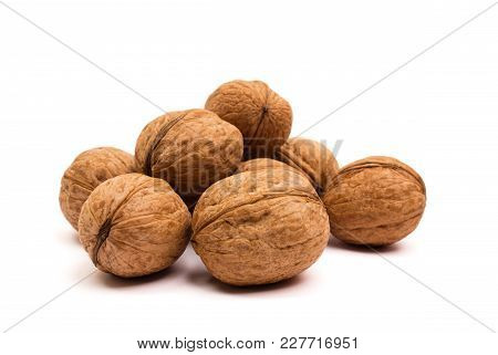 Group Of Walnuts On White. Healthy Organic Food Concept.
