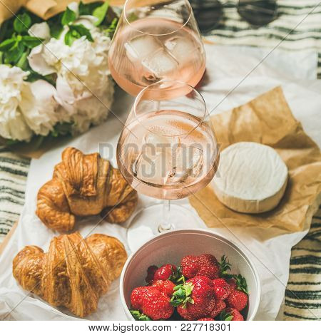 French Style Romantic Summer Picnic Setting. Flat-lay Of Glasses With Rose Wine, Fresh Strawberries,