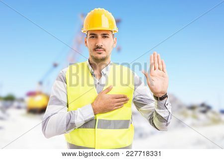 Confident Builder Or Contractor Making Oath Vow Gesture.