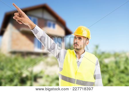 Visionary Architect Or Engineer Showing And Pointing Finger Up.