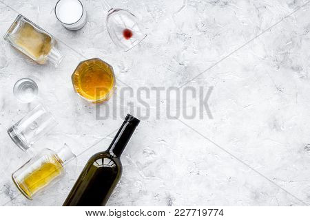 Alcohol Abuse. Drunkennes. Glasses And Bottles On Grey Background Top View.