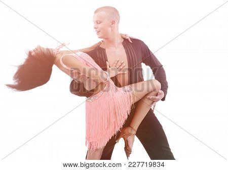 Beautiful ballroom couple performing their passionate exhibition
