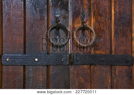Old Cellar Door Background Made Of Wood With Vintage Metal Lock