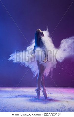 Woman In Undrewear And Pointe Shoes Jumping Gracefully In A White Dust Cloud And Color Light Rearvie
