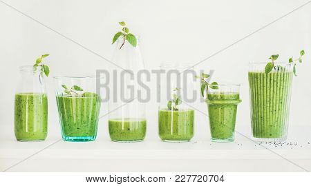 Matcha Green Vegan Smoothie With Chia Seeds And Mint In Glasses And Bottles, White Background. Clean