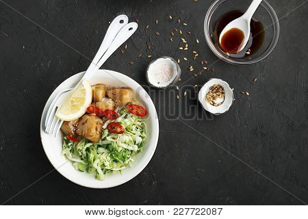 Cod, Marinated In Teriyaki, Quickly Fried, With A Green Salad Of Fresh Young Cabbage With Herbs And